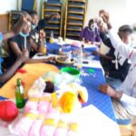 VCK Women and Youth Creating Beadwork and Mats